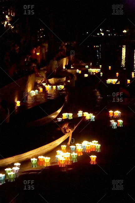 People celebrating the lantern festival in Hoi An, Vietnam
