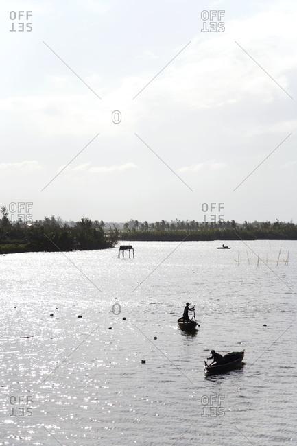 Fishermen on the Thu Bon river in Hoi An, Vietnam
