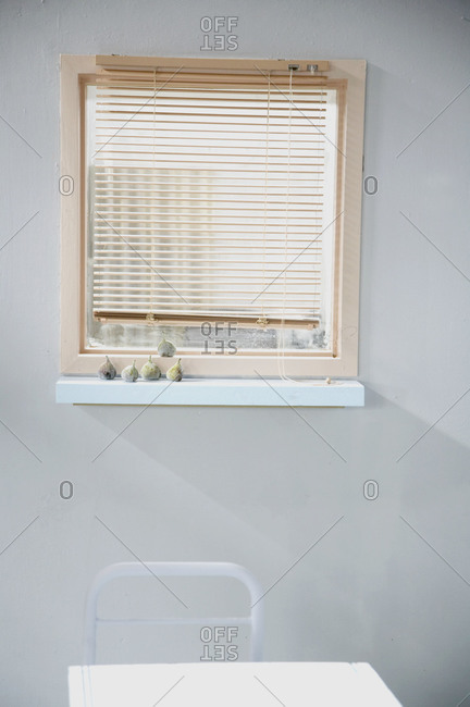Window with wooden blinds in a bright room