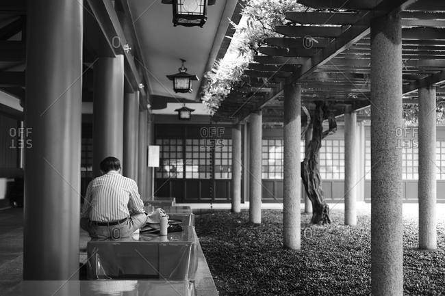 Man resting at Hie Shrine in Akasaka, Tokyo, Japan