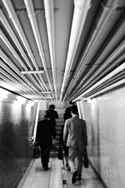 People walking  in Underground Marunouchi, Tokyo, Japan