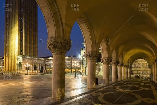 Italy, Venice, St Mark's Square, Colonnade of Doge's Palace at night