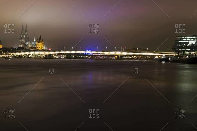 Germany, North Rhine-Westphalia, Cologne, view to Deutz Bridge, Great St Martin and Cologne Cathedral by night