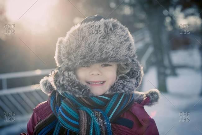 Smiling boy outdoors in winter, portrait