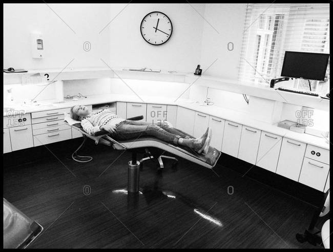 Girl lying in dental chair