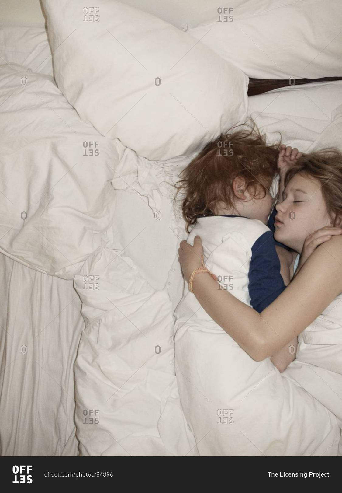 Brother and sister sleep together
