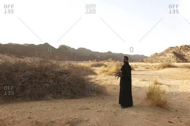 Tuareg man collecting firewood in the Algerian desert
