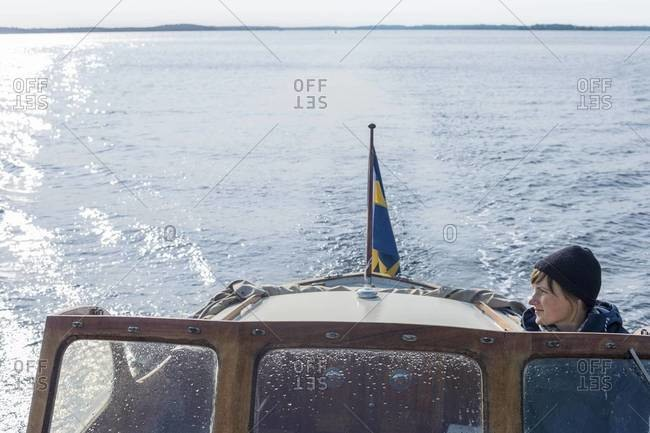 Woman on boat, Sweden - Offset