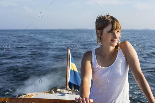 Young woman in boat, Sweden