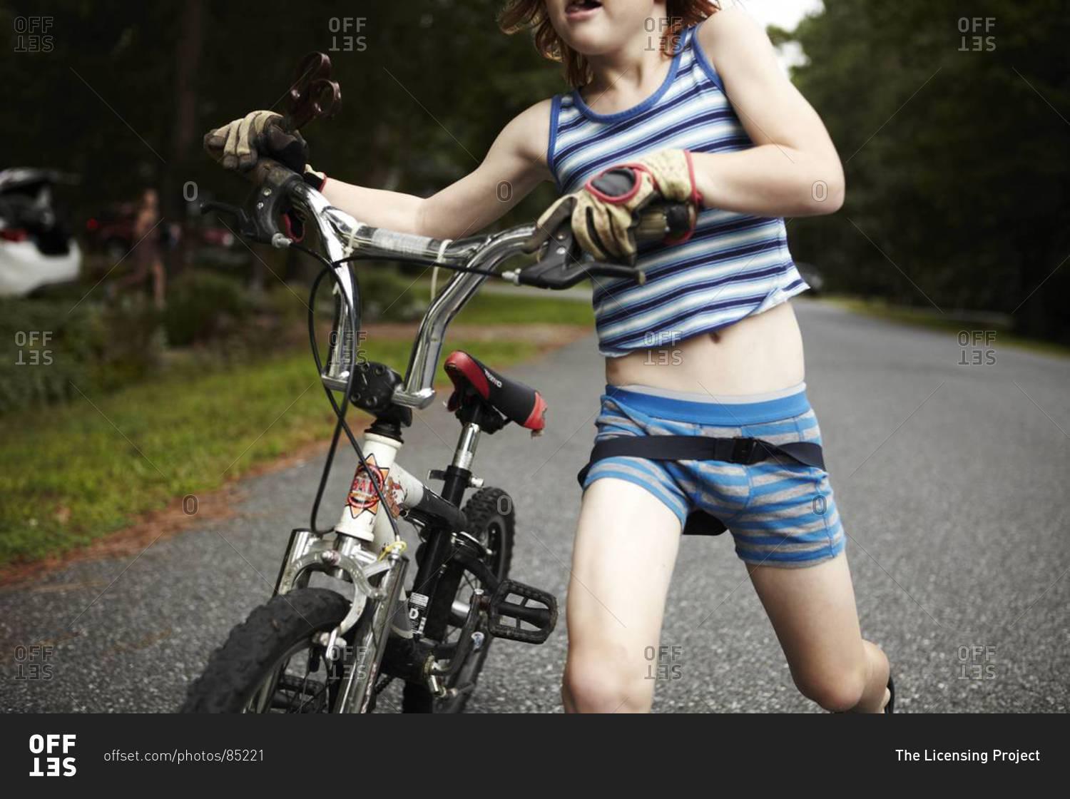 Close up of boy playing outside with a bike in his underwear stock ...