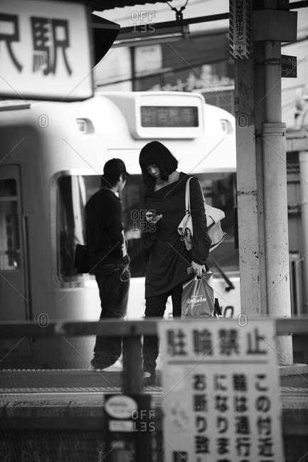 Tokyo, Japan - October 12,2011: Woman Waiting For The Train, Shimokitazawa, Tokyo, Japan