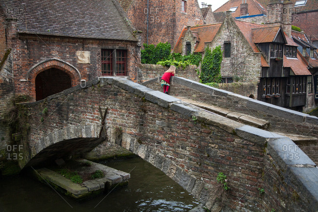 Young girl on bridge in Bruges, Belgium