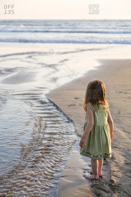 Young girl exploring Cannon Beach, Oregon