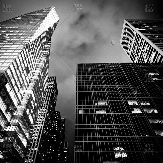 Low angle view of Manhattan skyscrapers at night