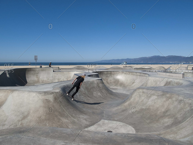 Man skateboarding in skateboard park, Venice Beach, California