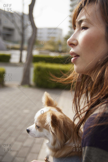 A woman with dog looking away