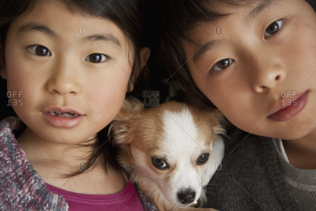 Boy and girl with dog, close-up