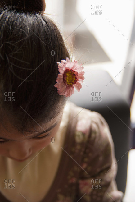 Teenage girl wearing flower in her hair, close-up