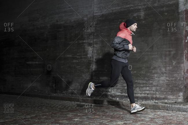 Full length of man jogging on street