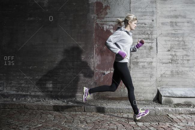 Full length of woman jogging on street