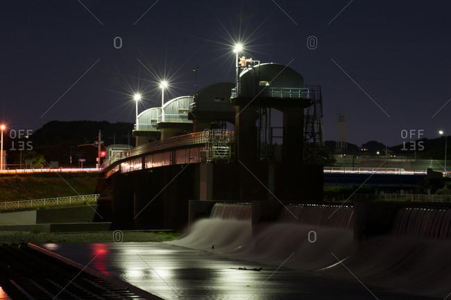 Small dam facility over Tama river at night near Noborito, Kanagawa Prefecture, Japan