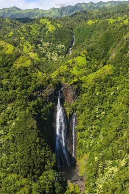 Aerial of a waterfall in the interior of Kauai, Hawaii