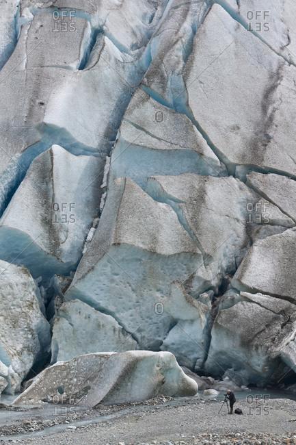 Photographer at the base of the Reid Glacier, Glacier Bay National Park, Alaska