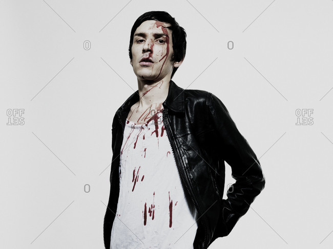 Portrait of a bleeding young man in leather jacket