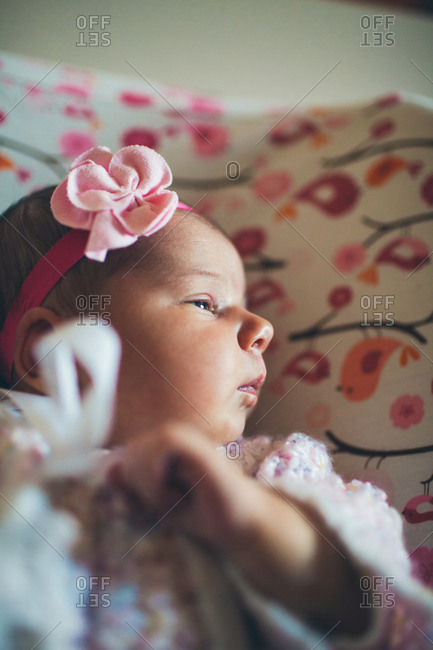 Profile of a baby girl lying down