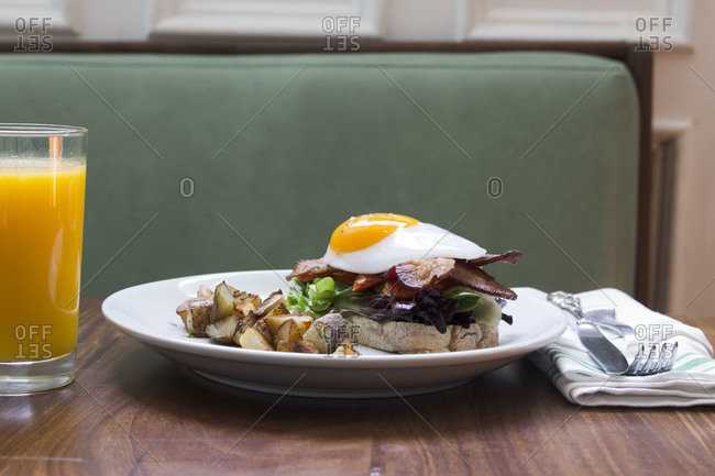 BLT sandwich served with duck egg topping and roasted potato