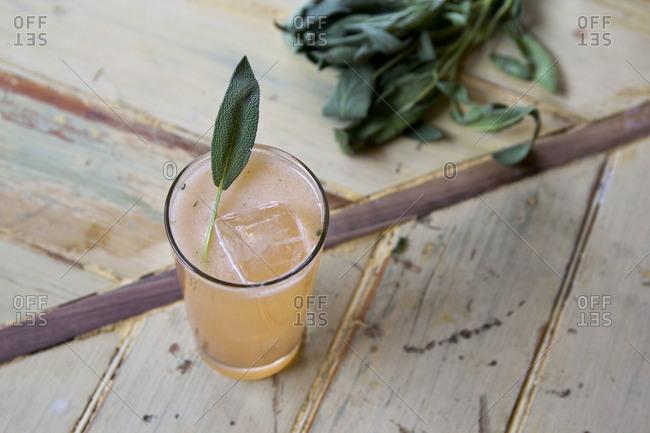 Cocktail garnished with sage