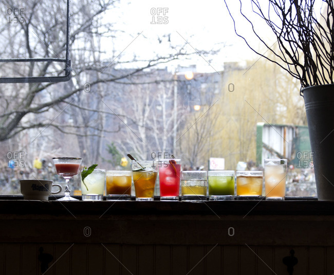 Various cocktails on a windowsill