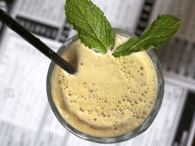 Dulce de Leche milkshake decorated with mint leaves