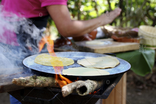 Chef making tortillas on a barbecue at a garden party