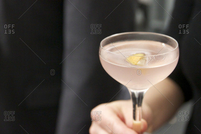 Close up of a woman holding a cocktail