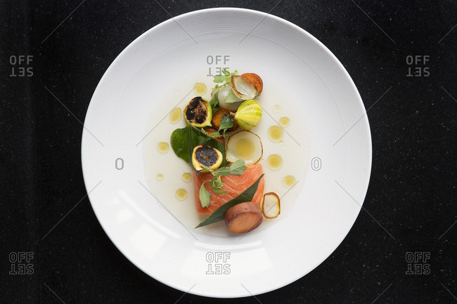 Smoked salmon served with vegetables