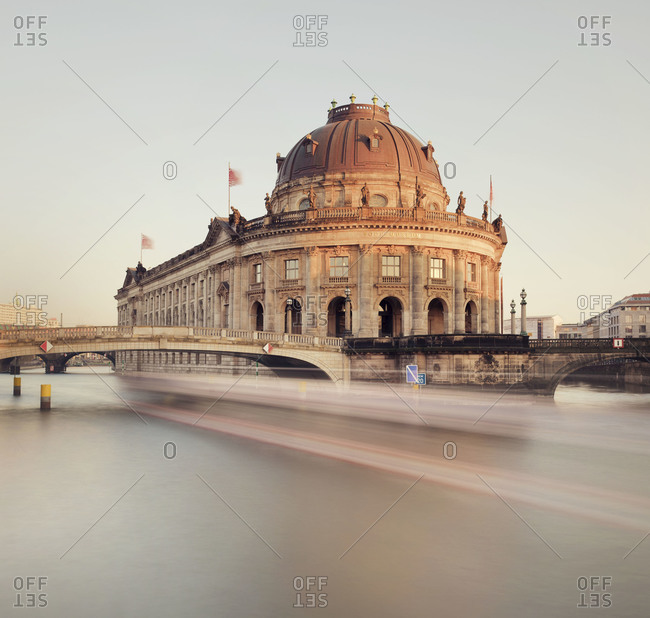 Bodemuseum with boat blurring along Spree River