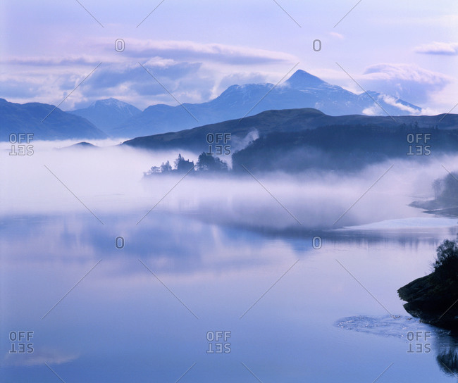 Morning mist rises above Loch Etive and a distant Ben Cruachan, Argyll