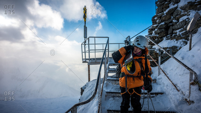 Chamonix, France - January 17, 2013: Hulya Vassail descending the stairs to Col des Grands Montets in cold and windy conditions