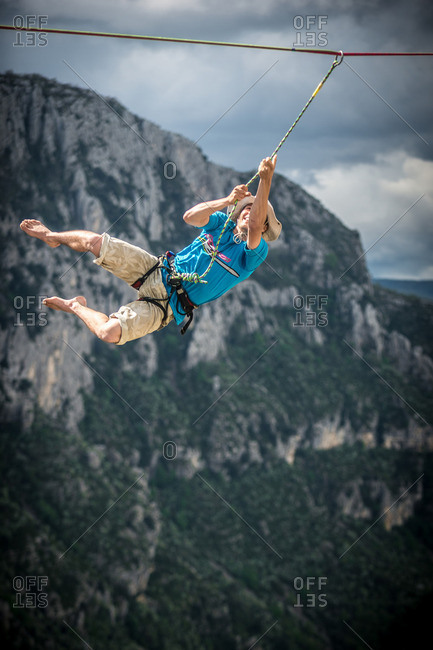 Verdon Gorge, France - May 6, 2013: Niccolo Zarattini taking a leash fall while highlining in the Belvedere Carrel sector of the Verdon Gorges
