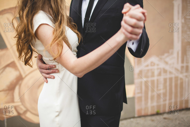 Groom and bride dancing on their wedding