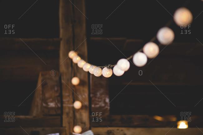 String lights hanging inside barn