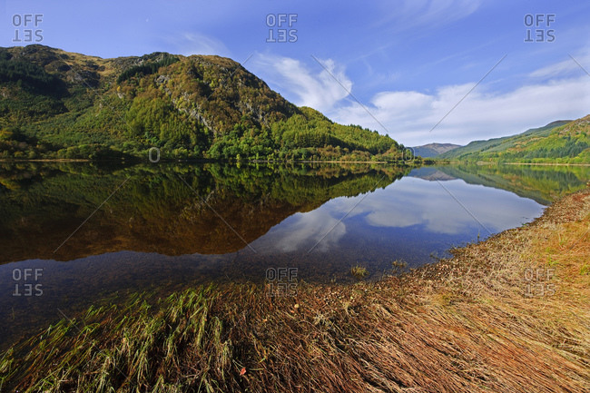 Peaceful reflections from the shore of Loch Lubneag