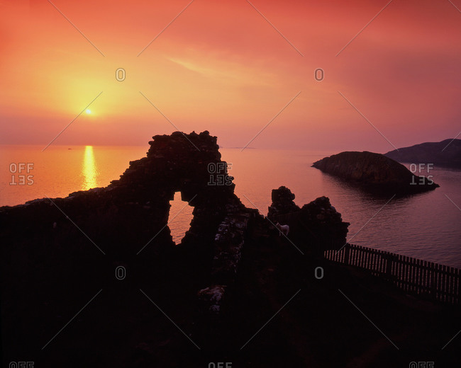 Ruins of Duntulm Castle at sunset on the Isle of Skye, Scotland