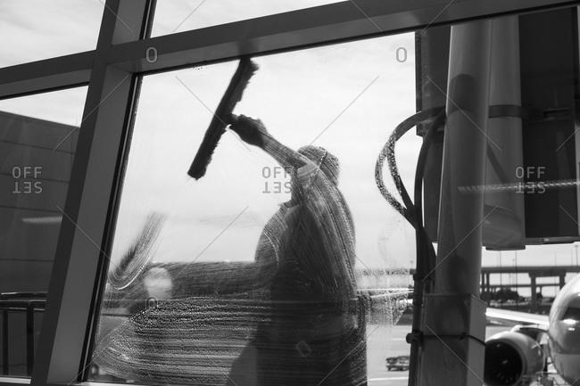 Window washer cleaning window