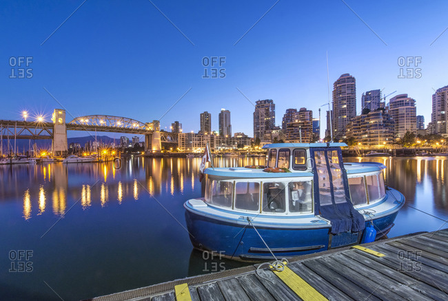 Waterfront skyline and harbor illuminated at night, Vancouver, British Columbia, Canada