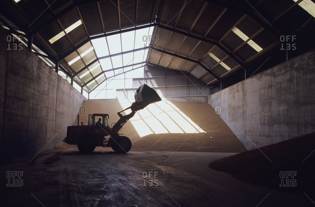 Front-end loader in grain warehouse