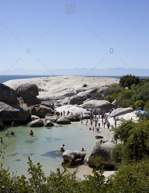 Boulders Beach, Cape Town - March 20, 2012: Tourist enjoying the water