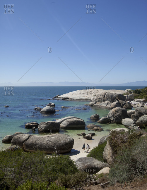 Boulders Beach, Cape Town - March 20, 2012: Two people walking on