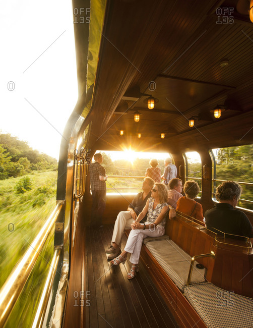 Feburary 10, 2012: Tourist watching sunset from the Observation Car on the Eastern & Oriental Express